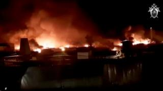 A still image taken from a video released by the Investigative Committee of Russia, showing the prison in flames