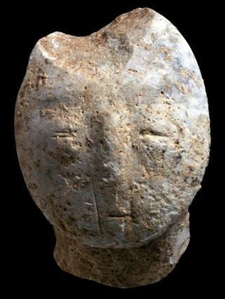 Figurine, depicting a human face