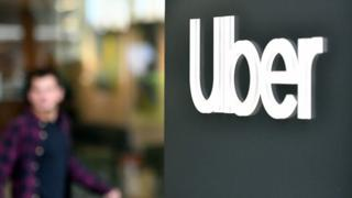 An Uber logo is seen on a sign outside the company's California headquarters
