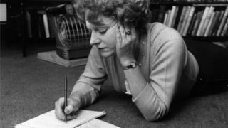 Spark makes notes on one of her novels in 1960