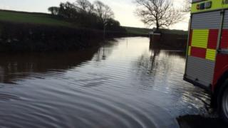 South Wales Police tweeted this picture of flooding on the South Gower Road
