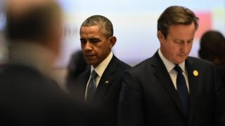 Obama and Cameron looking in opposite directions