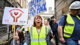 Mackintosh protests
