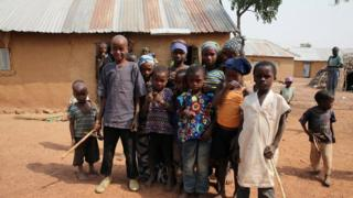 Children displaced by fighting in southern Kaduna, Nigeria in front a house where they took refuge.