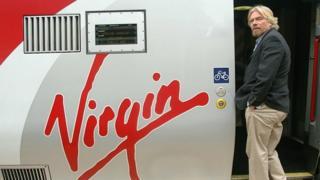 Richard Branson boards a Virgin train