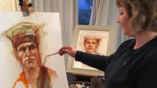 Margaret Ferguson working on one of her portraits