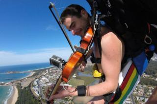Violinist skydives over Coffs Harbour in the nude
