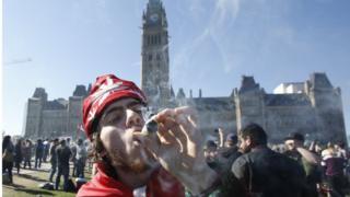 A man smokes marijuana during an annual 4/20 rally on Parliament Hill in Ottawa, Canada, April 20, 2016.