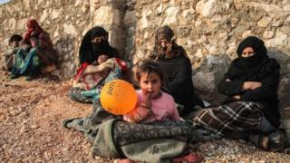 Displaced Syrians from Idlib province sit out in the open in the countryside