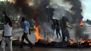 People protest against the coup with roadblocks and burning tyres, 19 Sept
