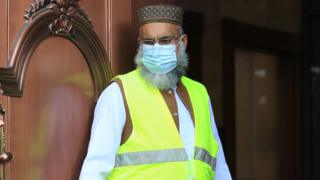 A worshipper in PPE at the Bradford Grand Mosque in Bradford, West Yorkshire