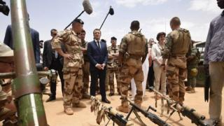 "French President Emmanuel Macron visits French troops in Africa""s Sahel region in Gao, northern Mali, 19 May 2017"