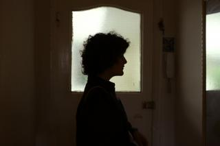 Gilda Bruno looks in a mirror as she leaves her home for an evening out