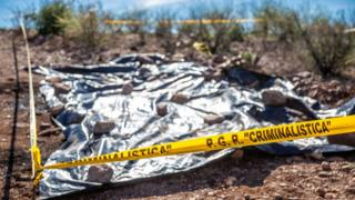 Police tape marks the place where the bodies of two American-Mexican families were found after their ambush in Northern Mexico