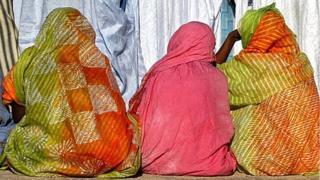 Women sitting down on the ground