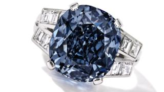 This undated photo provided by Sotheby's shows the 9.54 carat blue diamond ring worn for decades by child star-turned-ambassador Shirley Temple, which is going up for auction on April 19, 2016 by Sotheby's in New York