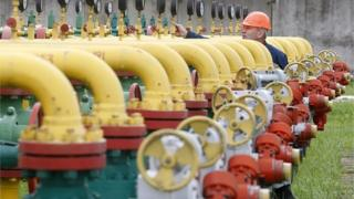 An employee checks equipment at the Dashava underground gas storage facility near Striy, outside Lviv