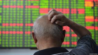 An investor scratches hiss head during he observing stock market at a stock exchange hall on July 1, 2015 in Hangzhou, Zhejiang Province of China.