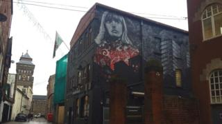 Artwork featuring musician Gwenno, outside Clwb Ifor Bach in Cardiff