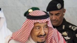 Saudi Arabia's King Salman bin Abdulaziz al-Saud accompanied by his personal bodyguard Gen Abdel Aziz al-Fagham