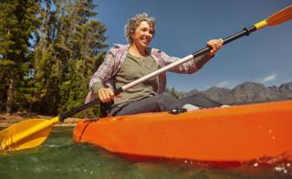 older woman in canoe