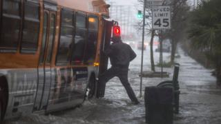 Man escapes flooding by getting on to bus