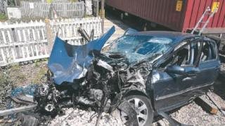 The car was hit by a freight train