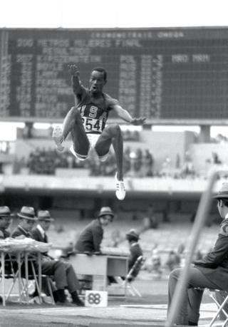 Bob Beamon of the USA breaks the long jump world record during the 1968 Olympic Games in Mexico City