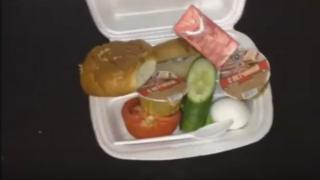 A still from the video showing the polystyrene box with the food inside