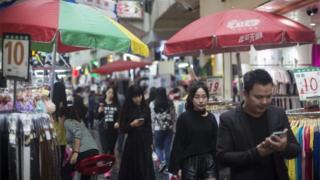 Shoppers in Shenzhen, China
