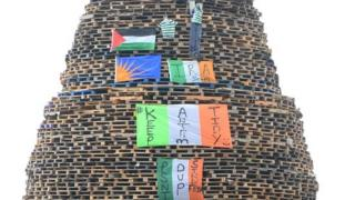 Irish tricolours and an effigy of Sinn Féin leader Gerry Adams were placed on the Ballycraigy bonfire in July 2014 but Colin White was prosecuted over a racist slogan