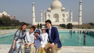 Canadian Prime Minister Justin Trudeau (R), accompanied by his wife Sophie Gregoire Trudeau (L) and their children pose for photographs at the landmark Taj Mahal in Agra, India, 18 February 2018.