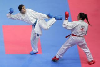 SEPTEMBER 08: Giana Lotfy (blue) of Egypt and Leila Heurtault (red) of France compete in the Womens Kumite -61kg final on day three of the Karate 1 Premier League at Nippon Budokan on September 8, 2019 in Tokyo, Japan.
