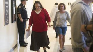 Rowan County clerk Kim Davis (left) walks through the halls of the courthouse on her first day back to work, after being released from jail last week, at the Rowan County Courthouse 14 September 2015 in Morehead, Kentucky.
