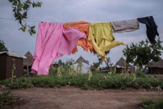 Clothes hang on a washing line in Palorinya refugee camp in northern Uganda