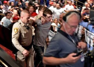 Police make arrest at Donald Trump's campaign rally at the Treasure Island Hotel Casino in Las Vegas, Nevada, 18 June