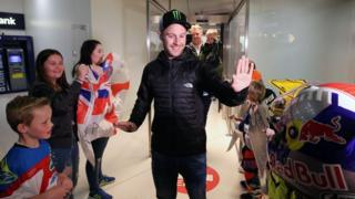 Jonathan Rea gives high-fives to some of his young fans