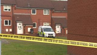 Police tape near the house in Wrexham where a body was found
