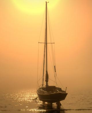 A boat on water at sunrise