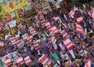 Tayvan'ın başkenti Taipei'de de çalışma koşullarının iyileştirilmesi çağrısı yapılıyor.