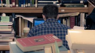 Métis Nation Saskatchewan - Stock picture of student surrounded by books