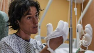 French mountaineer Elisabeth Revol talks to journalists in a French hospital