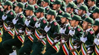 "Members of Iran""s Revolutionary Guards Corps (IRGC) march during an annual military parade."