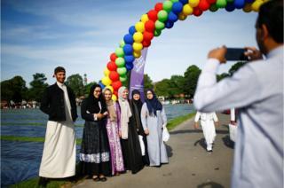 Muslims gather for Eid al-Fitr prayers to mark the end of Ramadan, in Small Heath Park in Birmingham, Britain, June 15, 2018