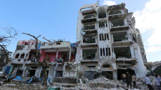 "Somali security forces stand in front of Hotel Ambassador on Maka Al Mukaram Road in Somalia""s capital Mogadishu"