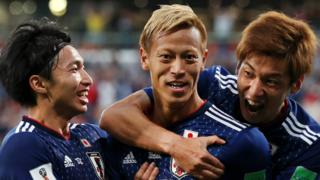 Japan's players celebrate scoring against Senegal at the 2018 World Cup