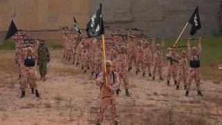 Young recruits to Islamic State wave black banners