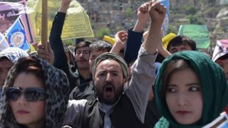 Afghan Hazara protesters chant anti-government slogans during a demonstration in Kabul
