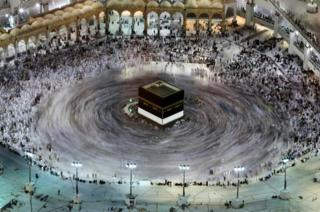 This long exposure photograph shows Muslim pilgrims circumambulation of the Kaaba, Islam's holiest shrine, at the Grand Mosque in Saudi Arabia's holy city of Mecca on 27 August 2017, prior to the start of the annual Hajj pilgrimage