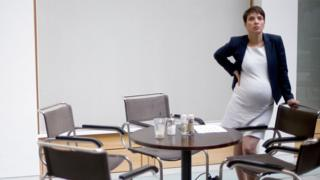 Frauke Petry, pregnant, at a table surrounded by chairs